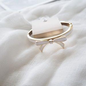 Bow white enamel gold hinge bracelet NWT